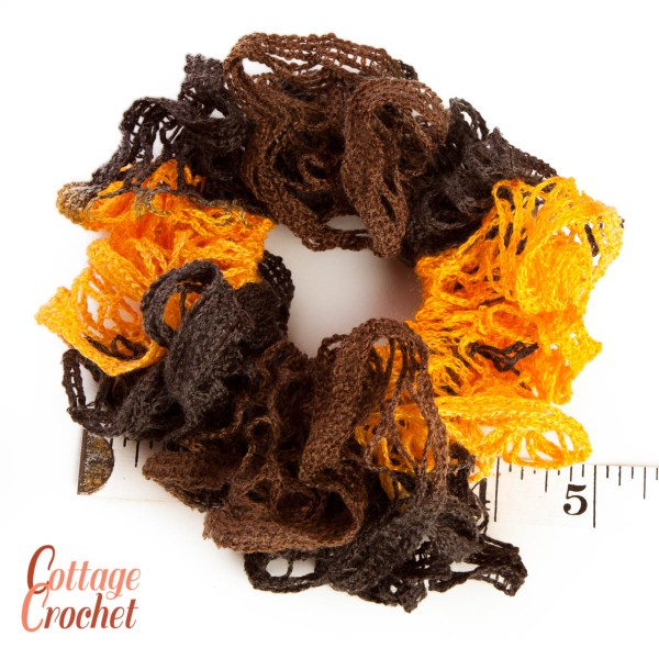 Yellow and brown frilly scrunchie