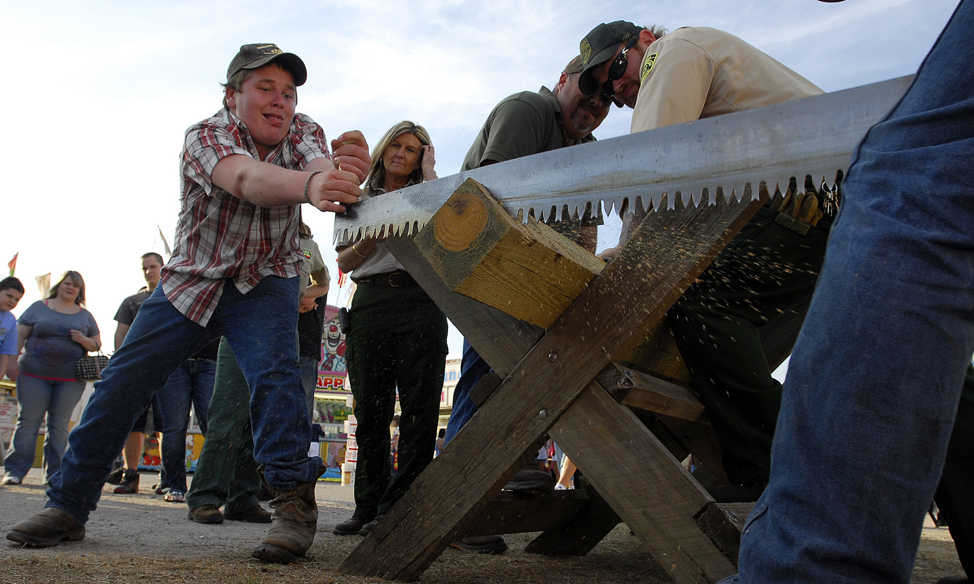 Tow boys compete in log saw contest.