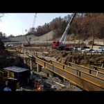 Steretts ac500/2 and ltm1400 setting girders in Shepherdsville ky