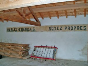 """Speak French, Be Clean"", written on the wall of the Ayguatébia-Talau school, to discourage speaking Catalan."