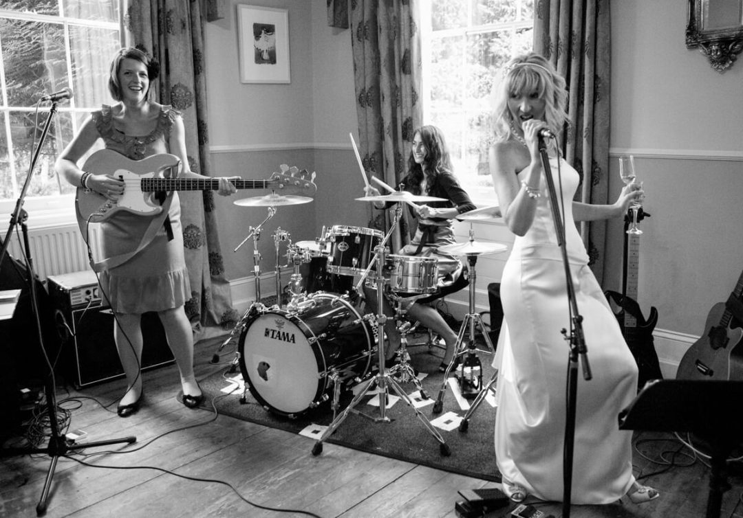 Bride singing on mic at Country house wedding