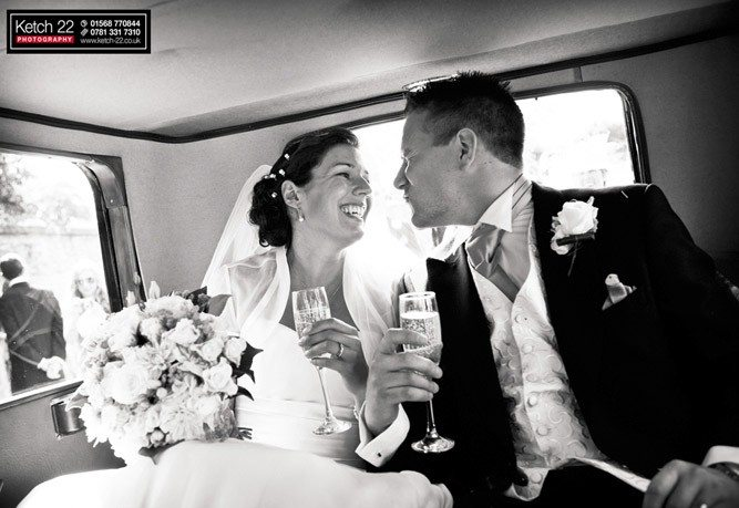 Bride and groom in wedding car Gloucestershire / planning your wedding day