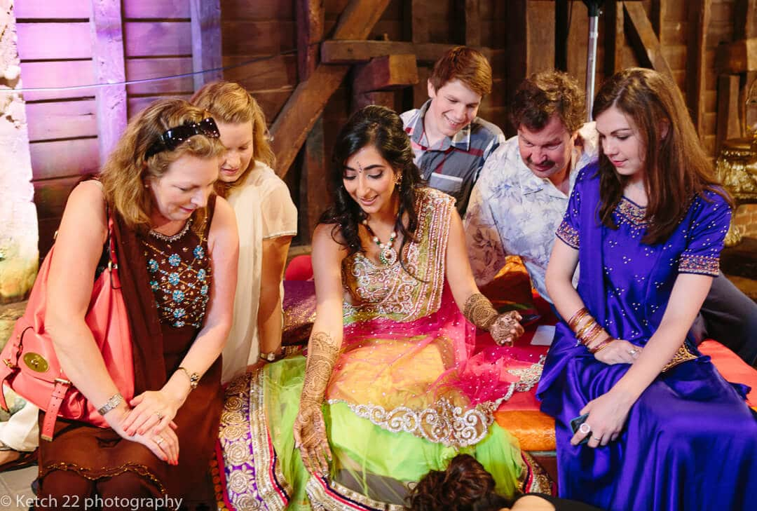 Wedding guests chatting to hindu bride