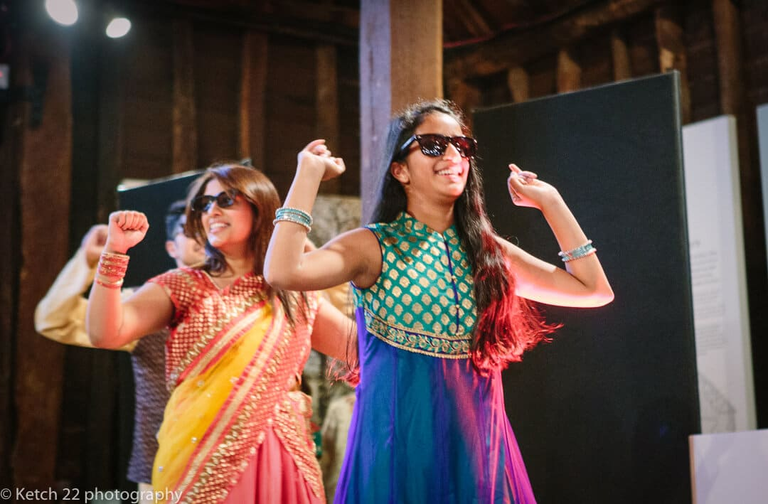 Dancers wearing sunglasses dancing at Indian henna night