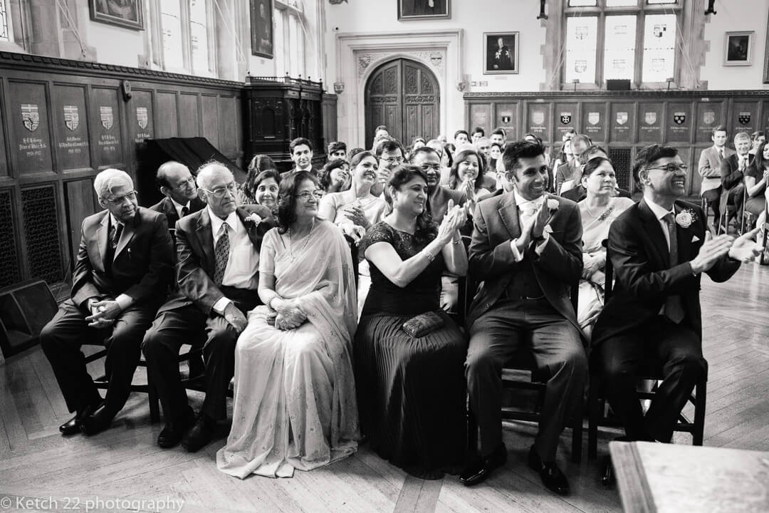 Wedding guests cheering at wedding ceremony