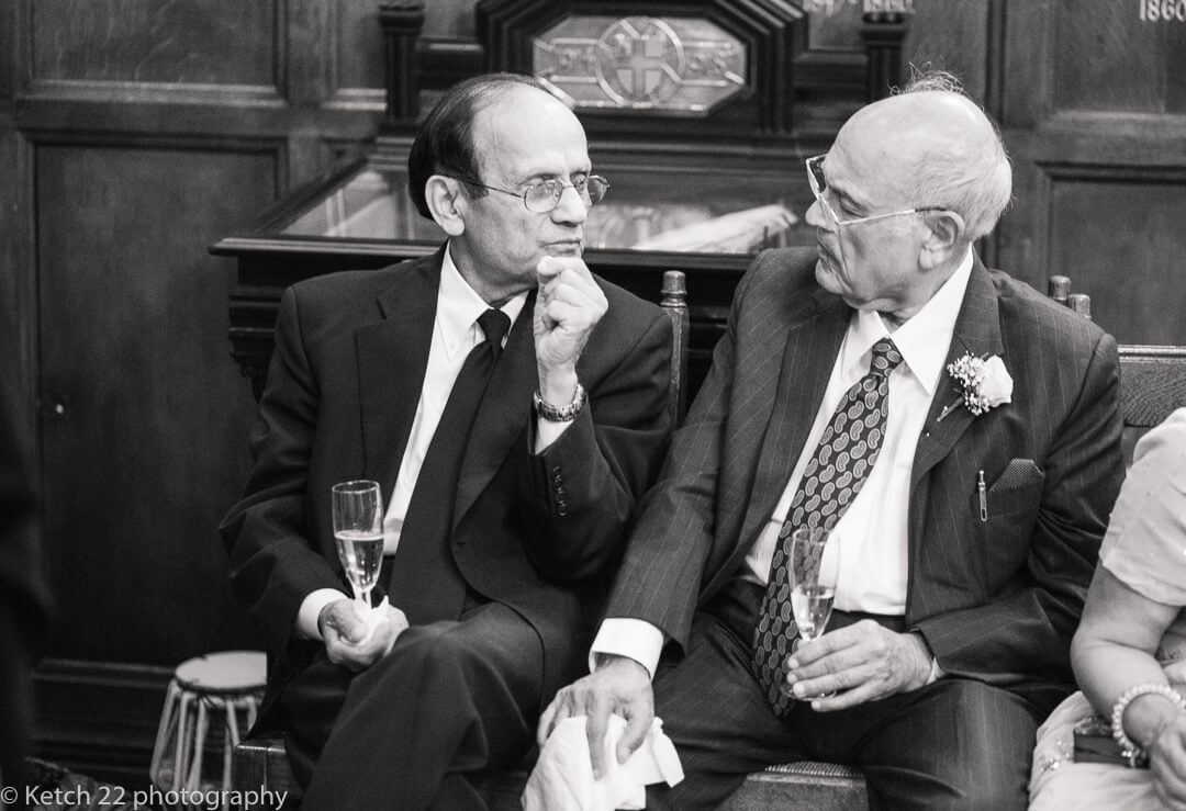 Two Granddad's chatting at wedding reception
