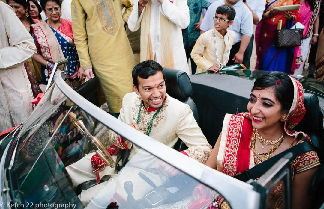 Hindu bride and groom in wedding car