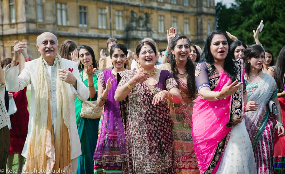 Wedding guests in colourful costumes at Hindu wedding