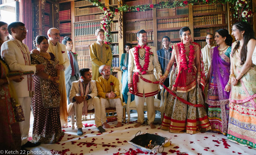 Bride and groom with wedding guests at Indian wedding ceremony