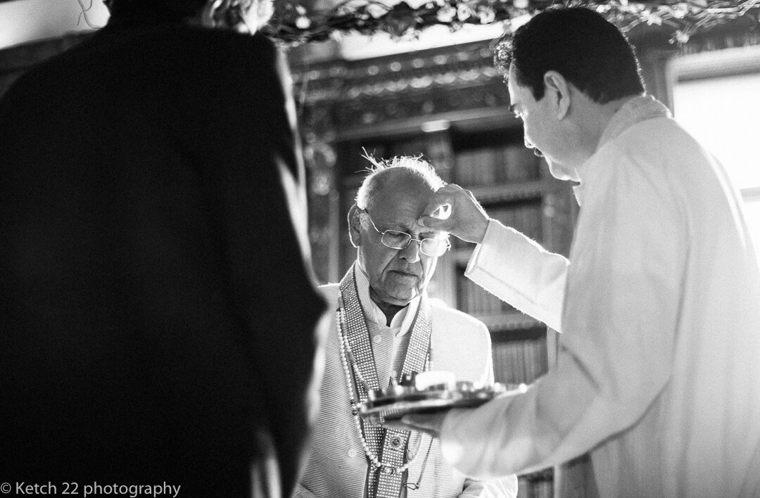 Uncle receives blessing from holy man at Hindu wedding