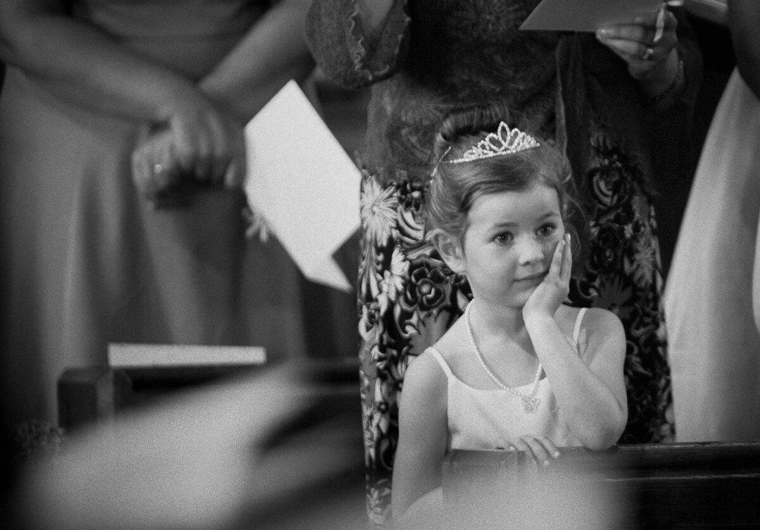 Flower girl in church for weddings at Kiftsgate Court Gardens