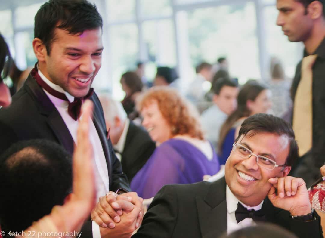 Groom greeting relatives at Hindu wedding