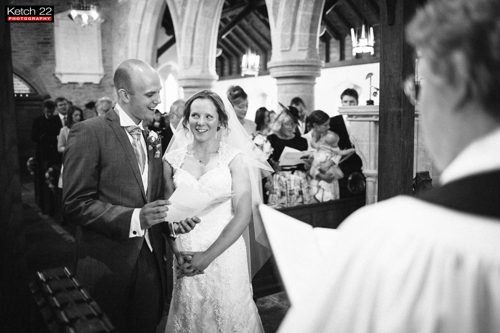 Bride and groom singing during wedding ceremony in Herefordshire
