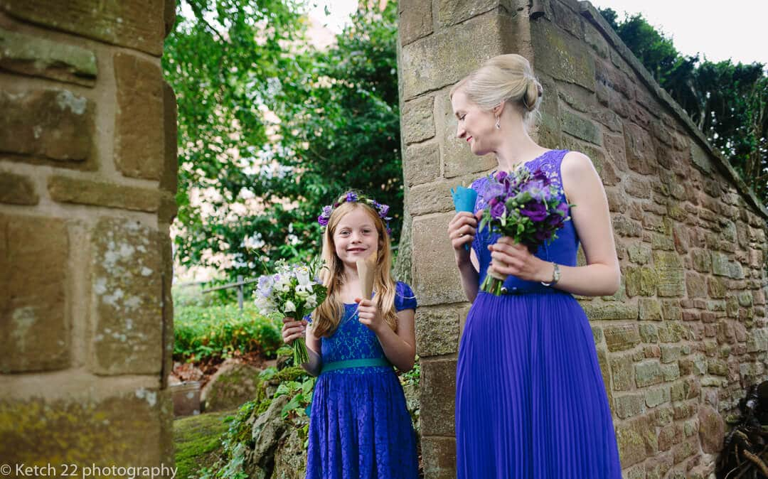 Bridesmaid and flower girl in blue waiting for bride at country House wedding