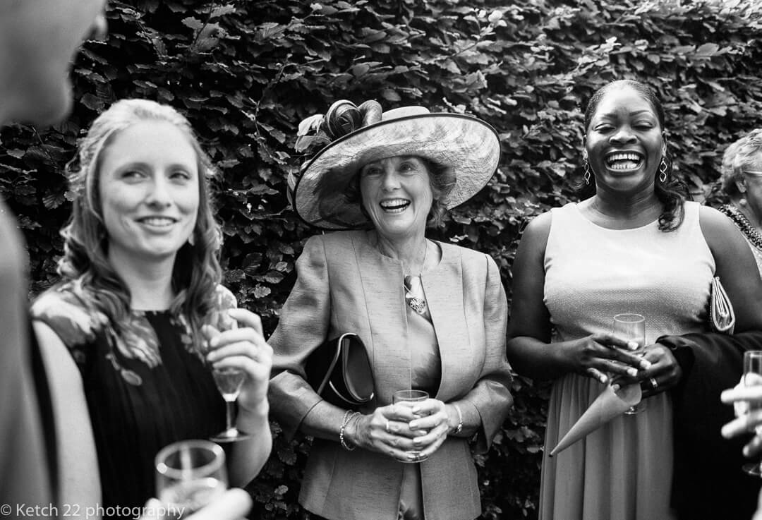 Mother of bride and wedding guests laughing at Herefordshire wedding