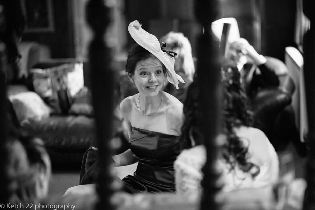 Wedding guest with fancy hat at Winter wedding in Herefordshire