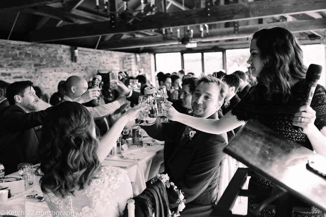 Wedding guests toasting at speechs in Herefordshire