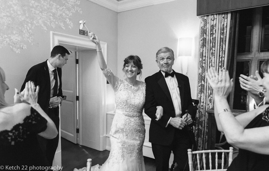 Bride and groom entering dinning room at Country House Manor in the Cotswolds