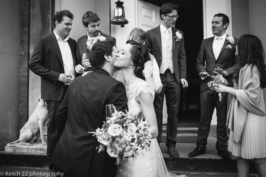 Bride kissing wedding guest at Country House wedding in Herefordshire