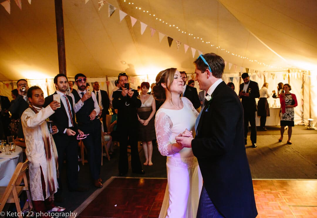 Bride and groom at first dance in wedding marquee