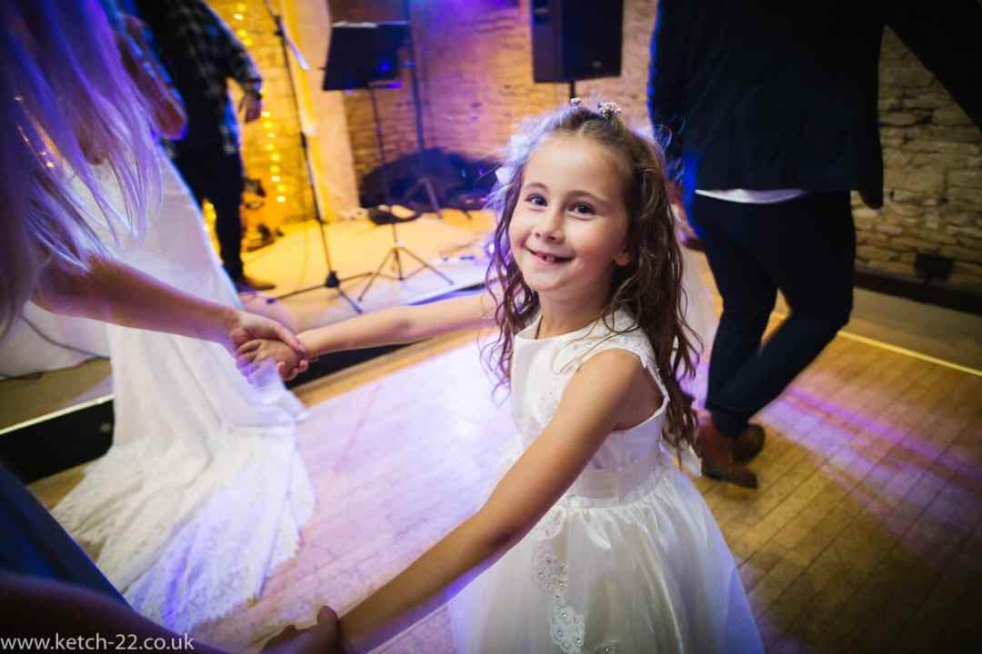 Flower girl dancing at wedding reception