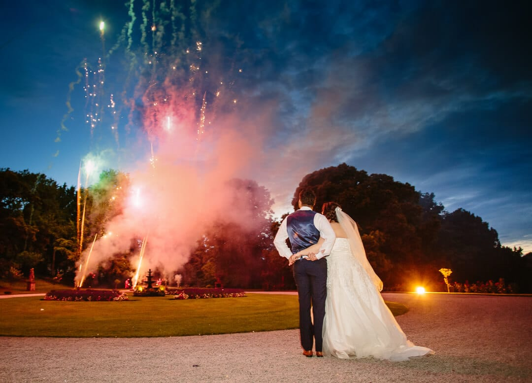 newly weds admire firework display at Clearwell Castle
