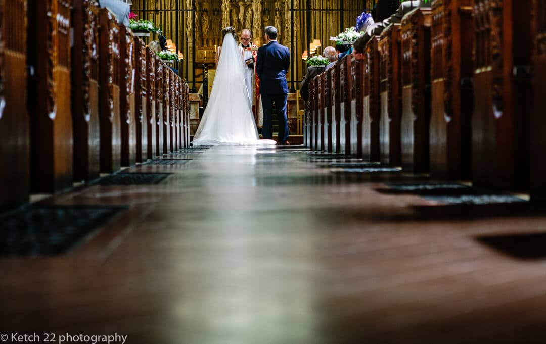 View from back of church of bride and groom during wedding ceremony