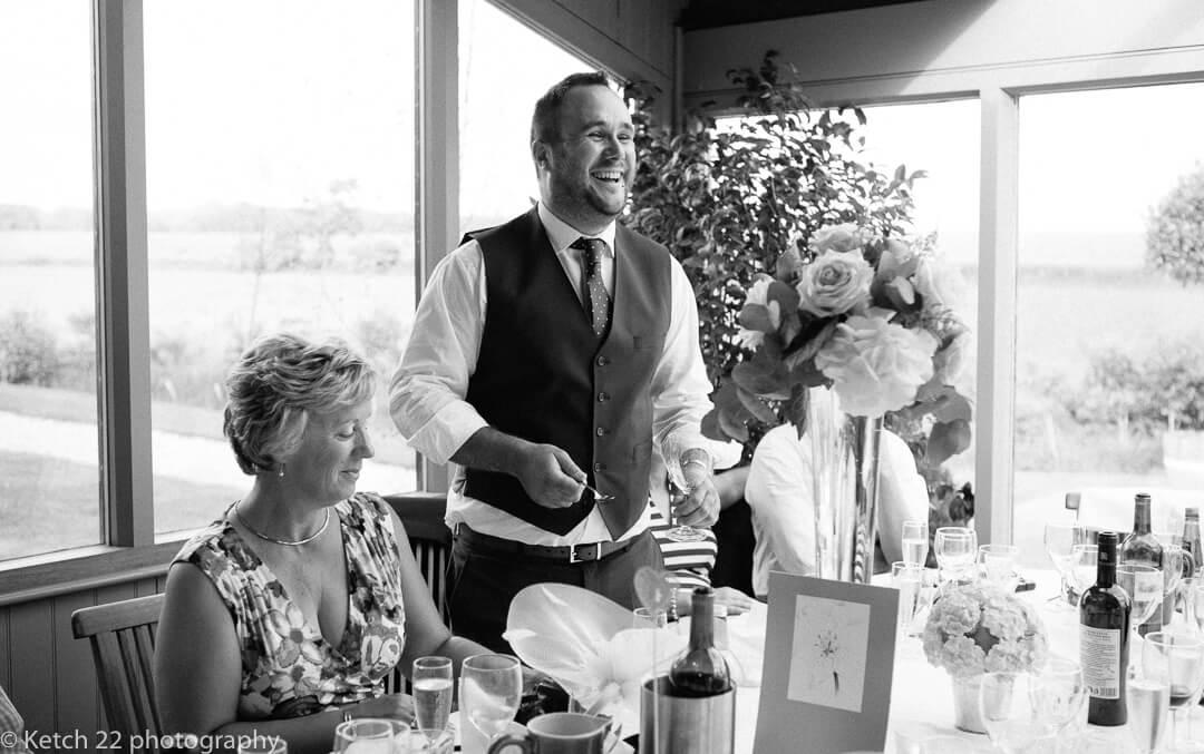 Best man making speeches at barn wedding