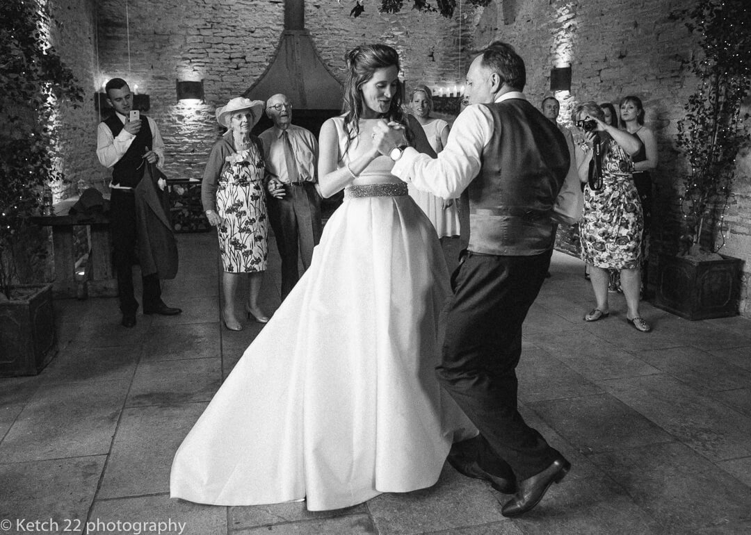 Bride and groom at first dance at barn wedding in Gloucestershire