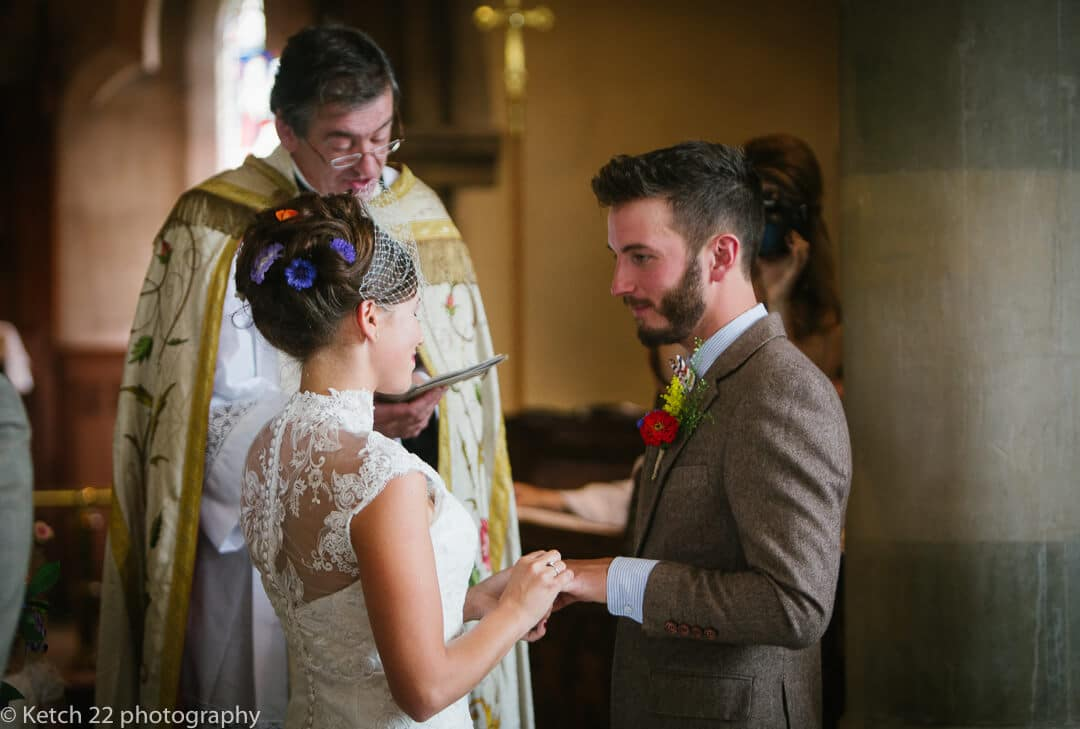 Bride and groom taking vows at vintage wedding