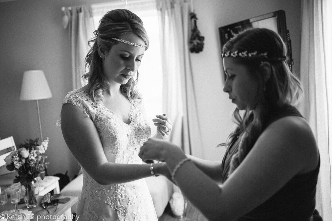 Bride putting bracelet at wedding preparations