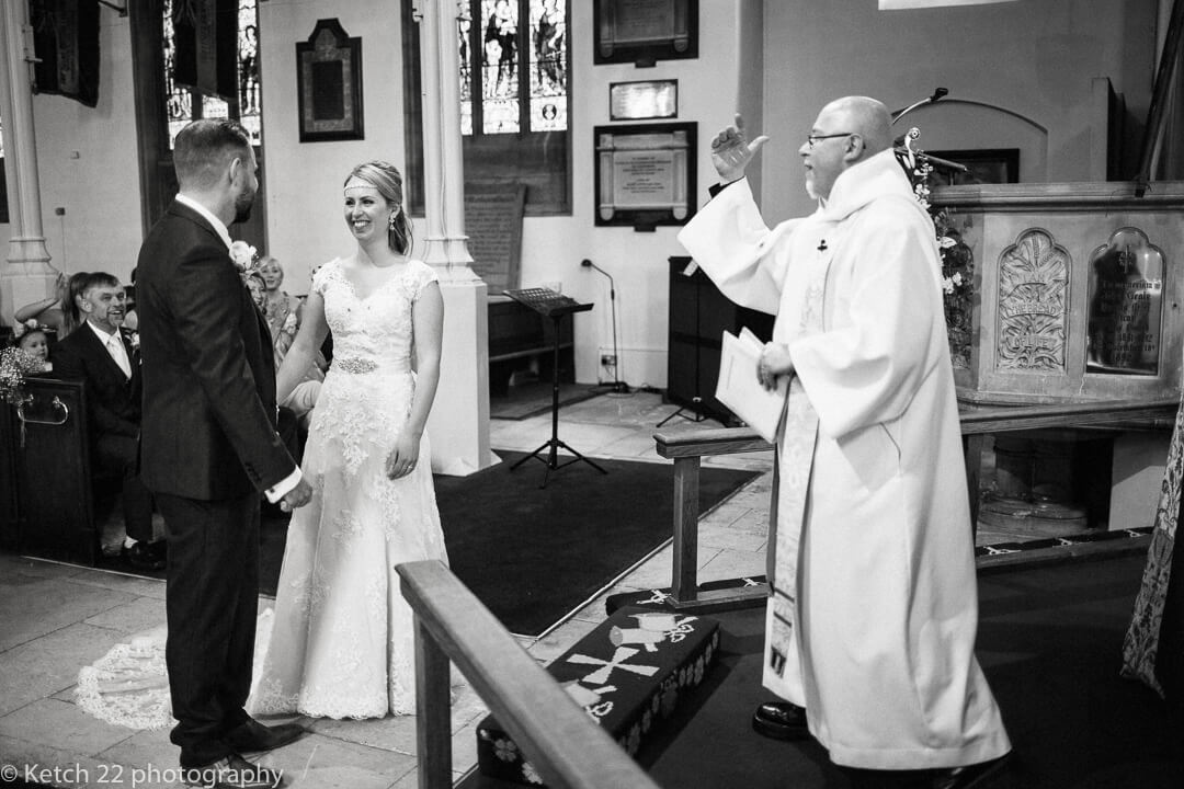 Bride and groom exchanging vows at church wedding in Stroud