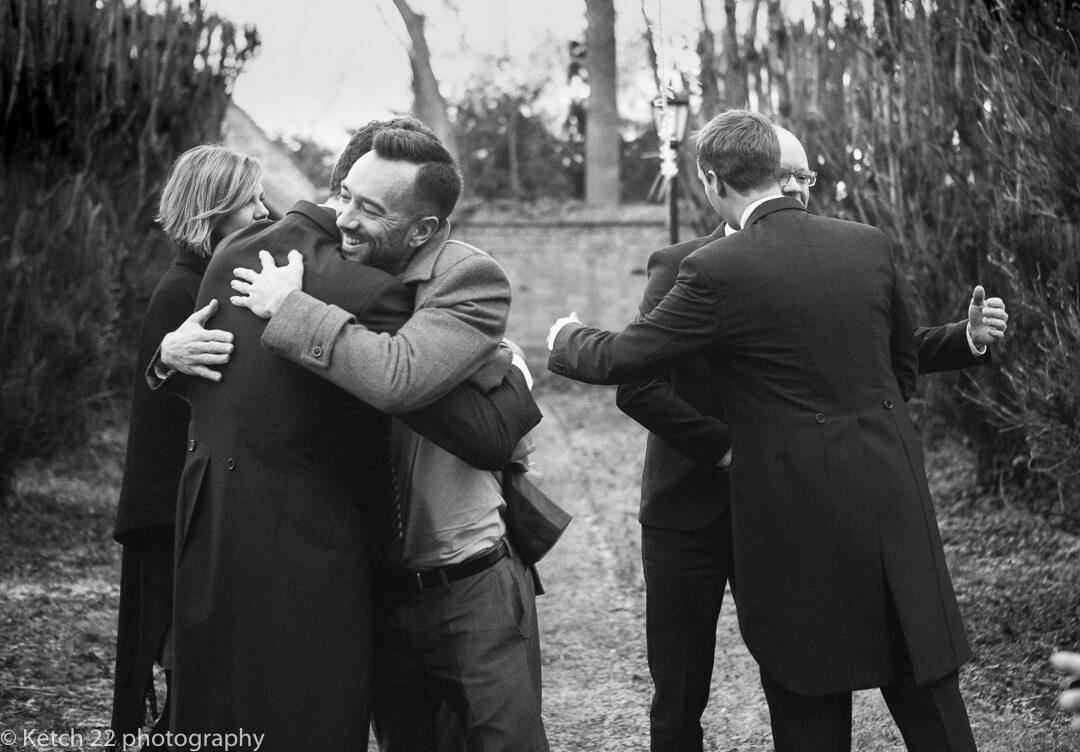 Ushers greeting guests at Winter wedding
