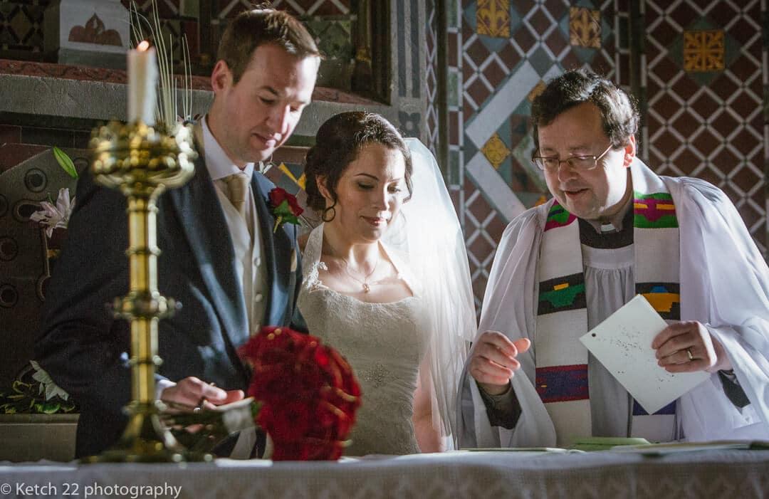 Bride and groom signing the registrar at church wedding