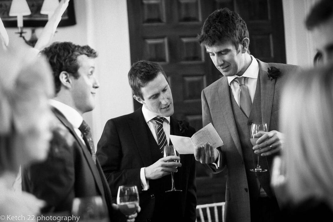 Wedding guests reading dinner menu at Elmore Court
