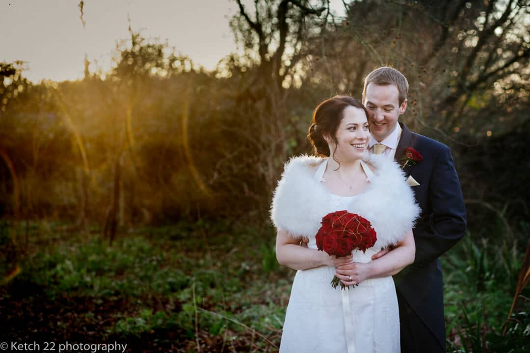 Portrait of Bride and groom with Winter sunset