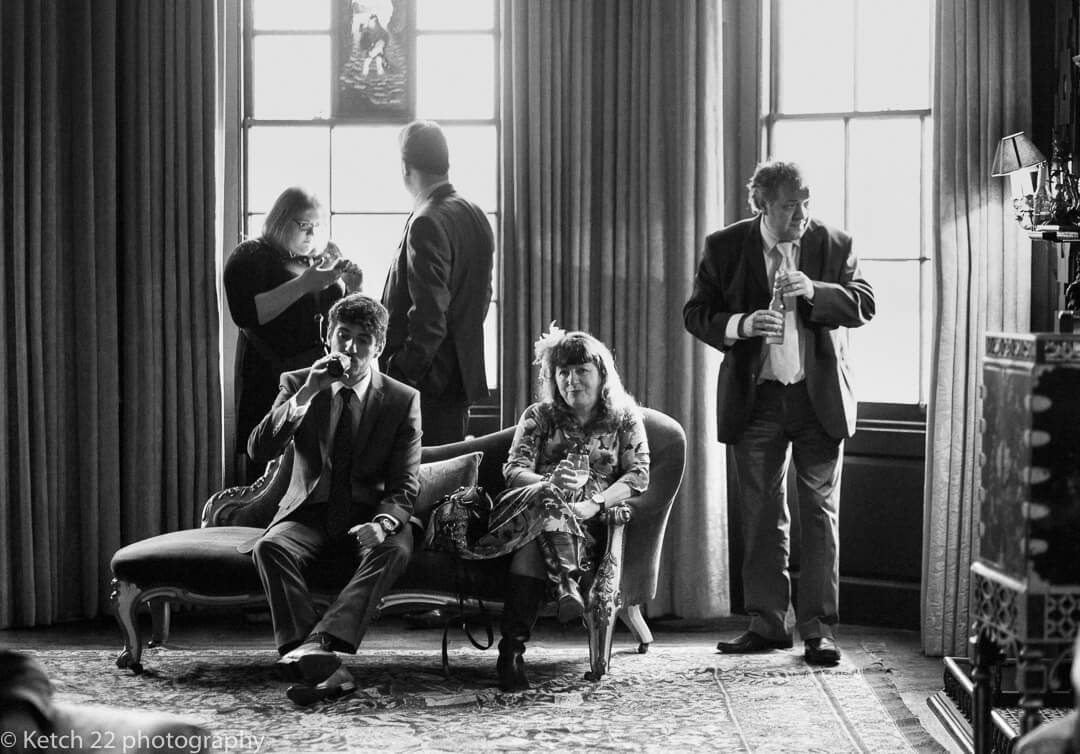 Story telling photo of wedding guests at Elmore Court in Gloucestershire
