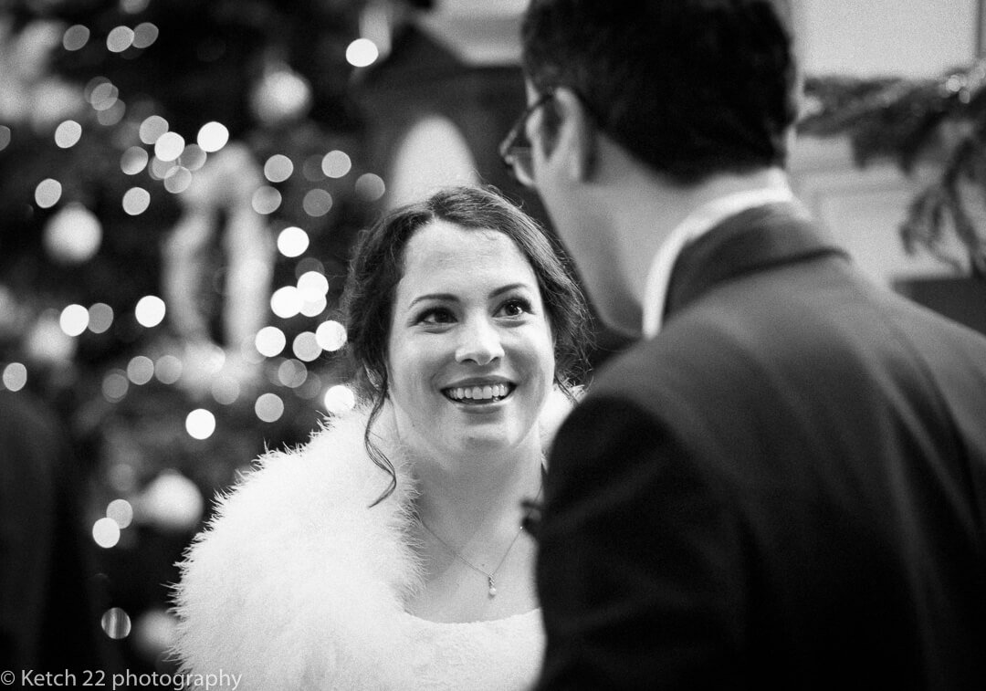 Bride chatting to best man at Christmas wedding