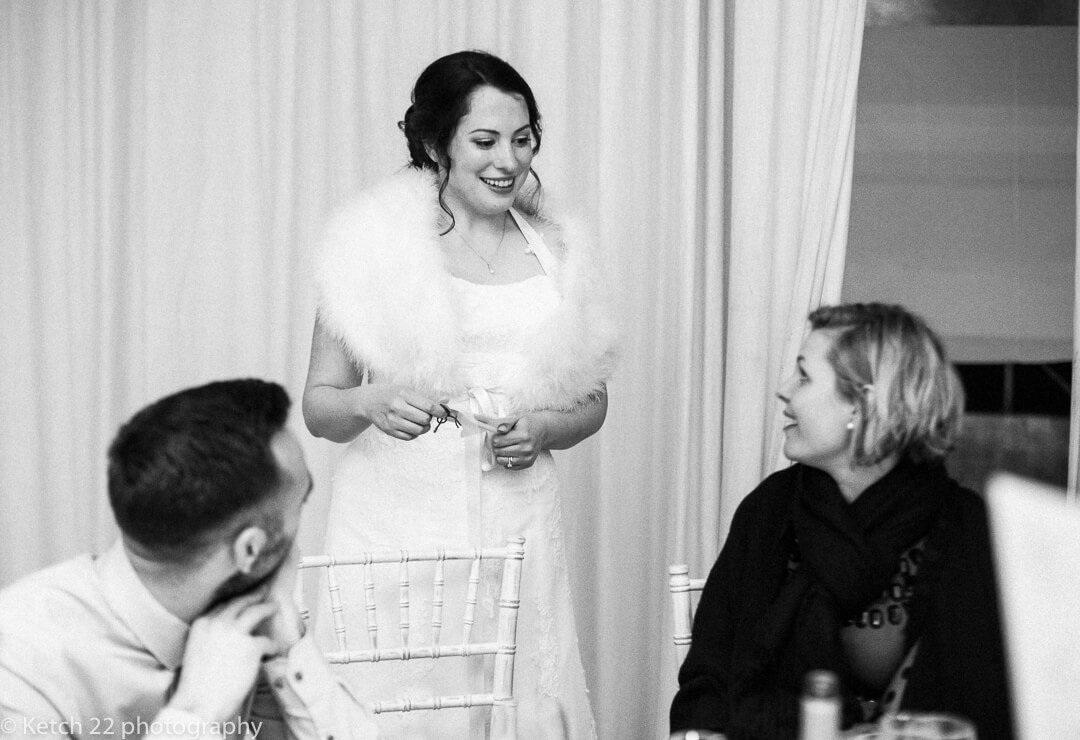 Bride chatting to wedding guests