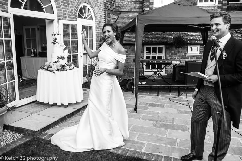 Bride and groom making speech at Dorset summer wedding