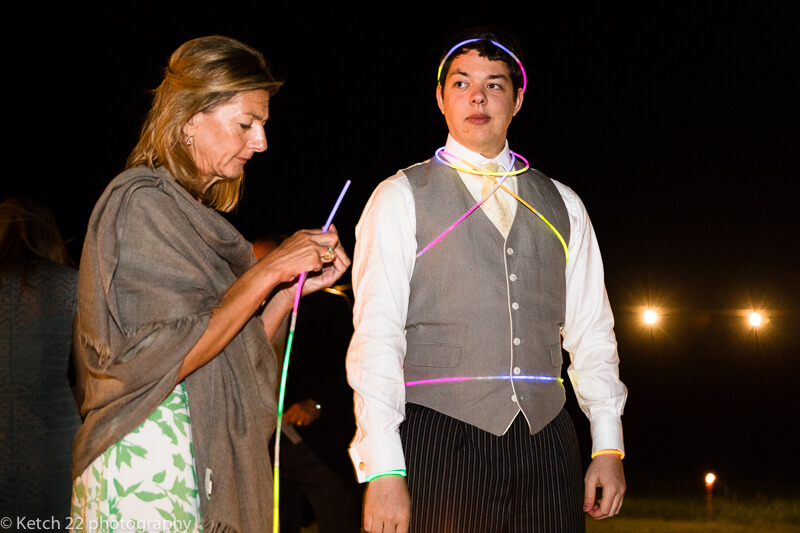Wedding guest wearing glow sticks in Dorset