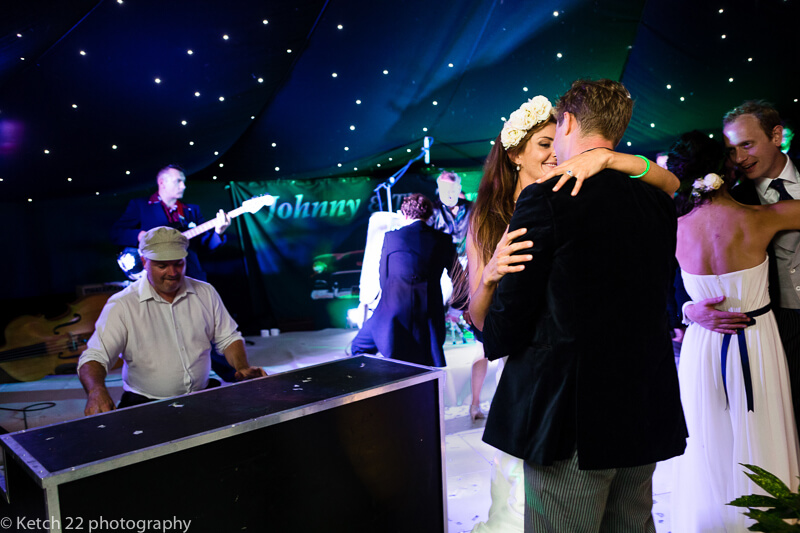 Bride and groom kissing at wedding reception in Dorset