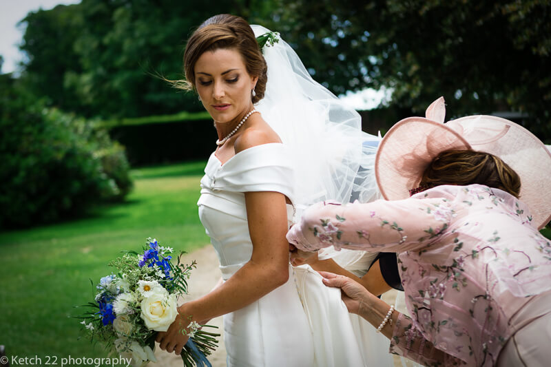 Mum getting bride ready before wedding ceremony in Dorset