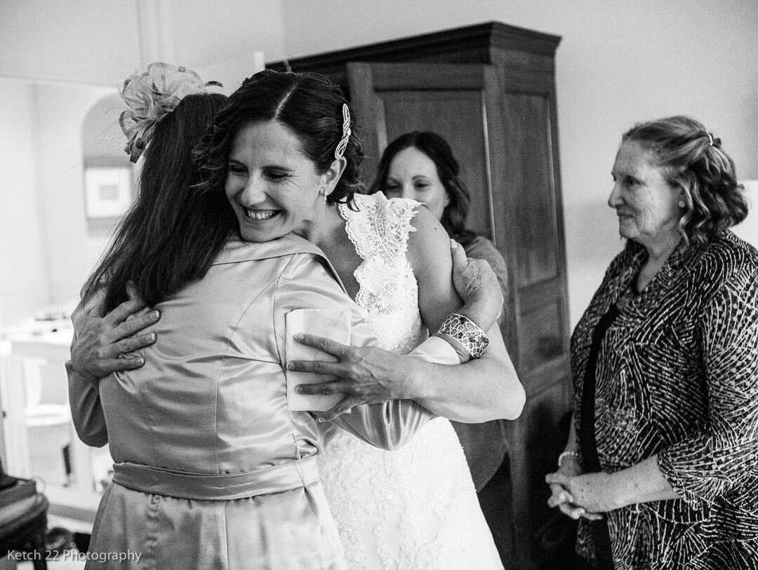 Wedding guest hugging bride at Gloucestershire wedding