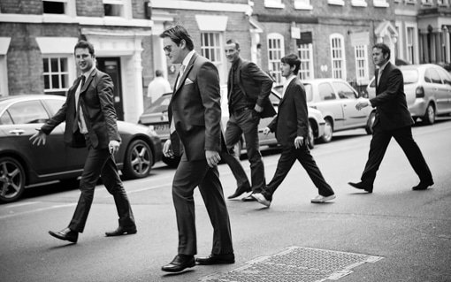 Gloucestershire Wedding Photographer image of Groom and groomsmen walking across a road