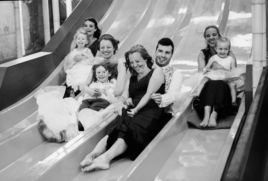 Bridal party on a big slide at The Barn at Berkeley
