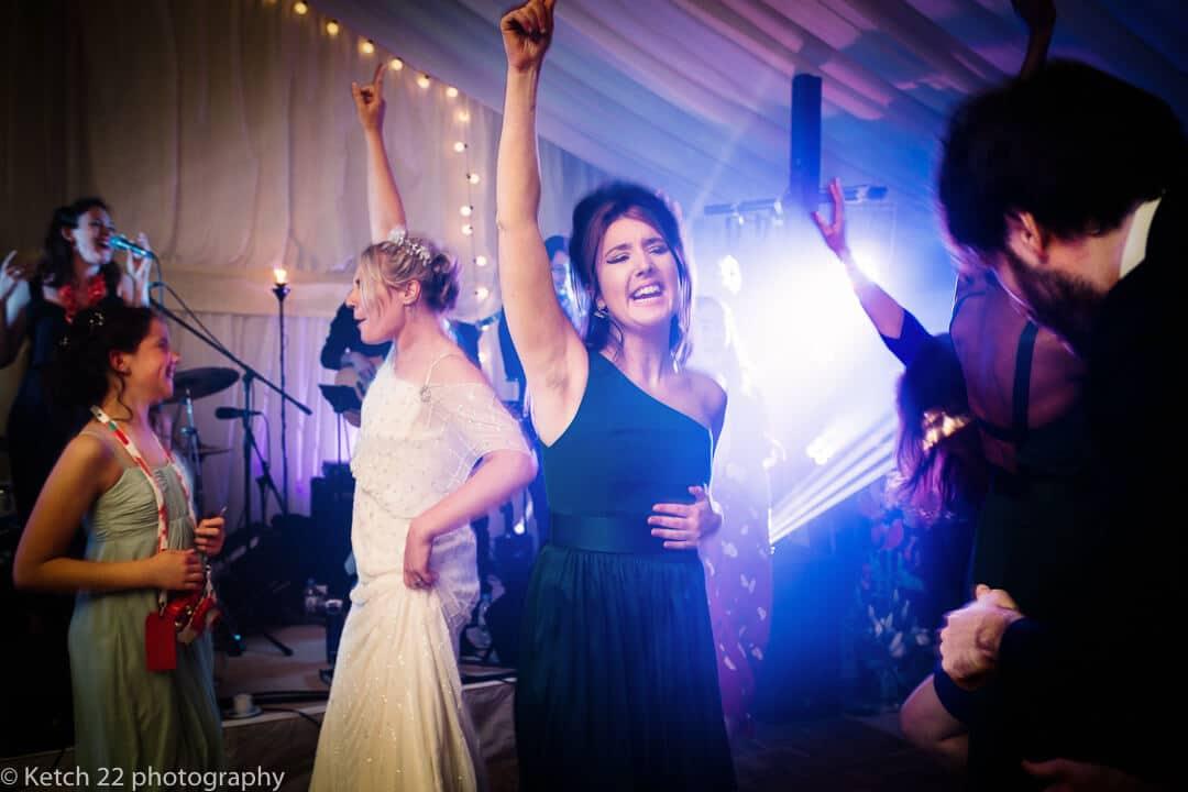 Bride and wedding guests dancing at reception