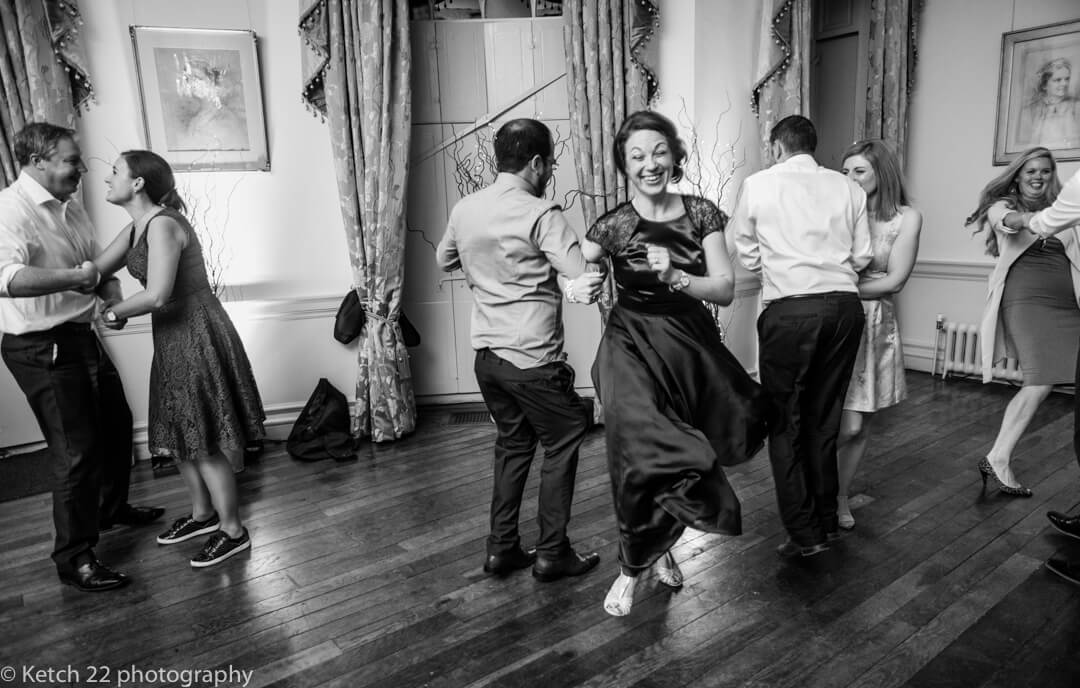 Wedding guests dancing at reception at Country house