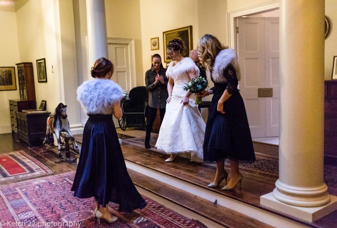 Bride walking through corridor at Country House wedding