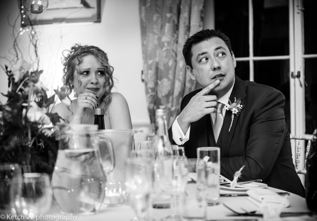 Groom and bride listen to wedding speeches at North Cadbury Court